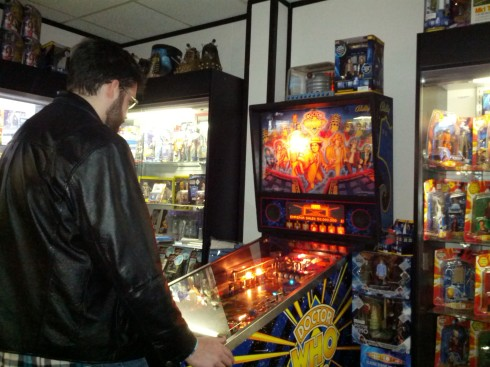 Ken playing the Doctor Who pinball at Who North America